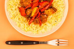 Indian Style Chicken Jalfrezi Curry And Pilau Rice. Against An Orange Background Stock Photos