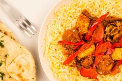Indian Style Chicken Jalfrezi Curry And Pilau Rice. Against A Pink Background With Naan Bread Stock Photography