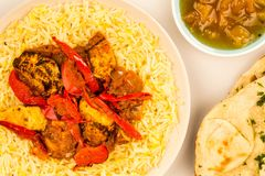 Indian Style Chicken Jalfrezi Curry And Pilau Rice. Against A Pink Background With Naan Bread And Mango Chutney Royalty Free Stock Photo