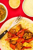 Indian Style Chicken Jalfrezi Curry And Pilau Rice. Against A Red Background With Mango Chutney And A Dipping Sauce Royalty Free Stock Photography