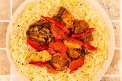 Indian Style Chicken Jalfrezi Curry And Pilau Rice. On A tiled Kitchen Table Top Royalty Free Stock Images