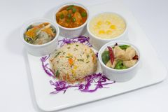 Sichuan Chicken, Sweet & Sour Fish, Mixed Vegetable, Fried Rice and corn Soup Platter. Royalty Free Stock Images