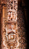 Indian style wood carved human figures column Stock Photo