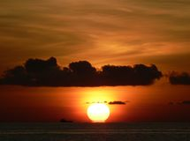 Indian Summer. The sun hits the Indian Ocean as it sets at the end of a nother beautiful day in the Maldives stock photo