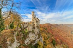 Indian Summer at Lichtenstein Castle. Panoramic view of the Lichtenstein castle in Honau near Reutlingen, a beautiful fairytale castle in Baden-Wuerttemberg Stock Image