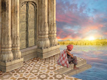 Indian sunrise. Old man meditating during the sunrise in India Royalty Free Stock Photos