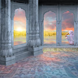 Indian sunrise. Woman meditating in a indian palace during the sunrise Royalty Free Stock Photography
