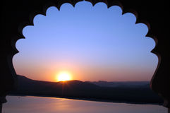 Indian Sunset. The sunset view through the arch of an Indian palace in Udaipur Stock Photography