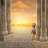 Indian sunset. Young boy in a hindu temple during the sunset Royalty Free Stock Images