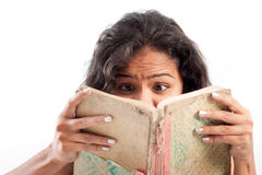 Indian surprised girl reading book Royalty Free Stock Images