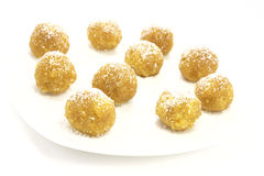 Indian sweet. Traditional indian sweet – laddoo on a white plate Stock Photography