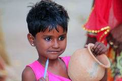 Indian sweet child. Small girl with a clay jug at the Sardar Market in Jodhpur Stock Photography