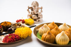 Indian sweet food called modak prepared specifically in ganesh festival or ganesh chaturthi stock image
