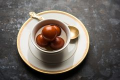 Indian sweet Gulab Jamun served in a ceramic bowl, selective focus stock image