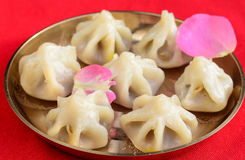 Indian Sweet- Modak. Made of coconut,jaggery nuts steamed in rice flour dumplings stock photo