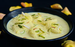 Indian Sweet - rasmalai. Rasmalai: Indian Sweet prepared out of Milk,chenna -cottage cheese, sugar and aromatic ingredients Royalty Free Stock Image