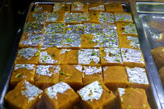 Indian Sweetmeats with Silver foil Stock Images