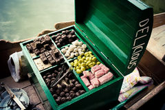 Indian sweets in big green box. Stock Image