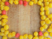 Indian Sweets - Boondi frame on wooden background. Close up of boondi frame on wooden background stock image