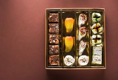 Indian sweets and Mithai. Indian sweets and candies in a box royalty free stock image