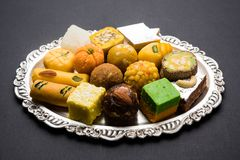 Indian sweets for diwali festival or wedding, selective focus. Stock photo of Indian sweets served in silver or wooden plate. variety of Peda, burfi, laddu in royalty free stock photo