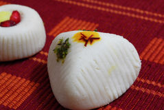 Indian Sweets Mithai. An isolated shot of White Indian Sweets Mithai decorated with saffron royalty free stock photo