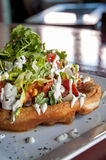 Indian taco. This is a picture of a gourmet indian taco. It is on fry bread with tuna, and lots of toppings royalty free stock photo