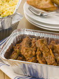 Indian Take Away- Beef Madras And Pilau Rice Stock Photography