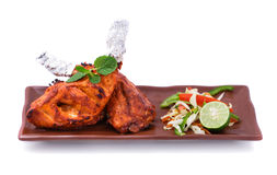 Indian tandoori chicken served with salad. Portrait of indian tandoori chicken served with salad isolated on white background Stock Photography