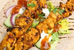 Indian Tandoori Chicken Tikka Kebabs. Indian chicken tikka kebabs served with chappati, salad and mango chutney Stock Image