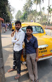 Indian taxi driver posing in front of his cab in Kolkata Stock Images