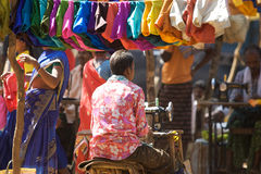 Indian taylor at the tribal market. India, Orissa: indian taylor at the tribal weekly market. The weekly market is the economic istitution in the rural area on Stock Image