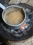 Indian Tea. Being prepared in a vessel stock images