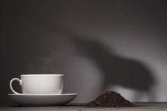Indian tea. In a cup and a shadow of an elephant Royalty Free Stock Photo