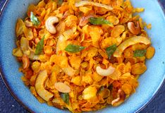 Closeup of vegan Indian snacks- cornflakes mixture in a large blue ceramic bowl stock image