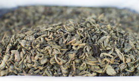 The Indian teais green in bulk on a market counter Stock Image