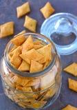 vegan Indian snacks- namak paare salty crackers in a glass jar royalty free stock images