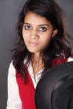 Indian teen in black hat Royalty Free Stock Photography