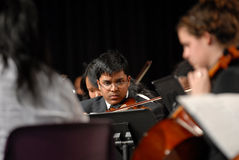 Indian teen boy play violin. Philadelphia, PA April 1 - unidentified Indian teenage boy plays the violin during the Grover Washington Spring Music Concert at royalty free stock images