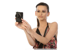 Indian teenage girl with camera. On the white background Stock Photos