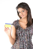 Indian Teenage  girl with  credit card. Teenage Girl with gold color credit card over white background Royalty Free Stock Photography