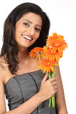 Indian teenage girl with daisy flowers Royalty Free Stock Photos