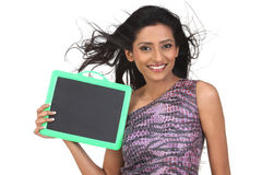 Indian Teenage girl with empty slate Royalty Free Stock Photography