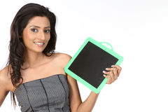 Indian Teenage girl with empty slate Stock Photography