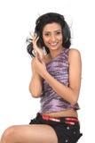 Indian  teenage girl enjoying music Stock Photos