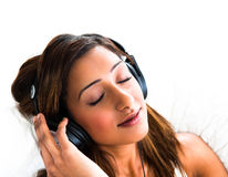 Indian teenage girl, with headphones, eyes closed Royalty Free Stock Photo