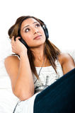 Indian teenage girl, with headphones, eyes open Stock Images