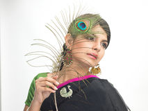 Indian teenage girl holding peacock feather Royalty Free Stock Photography
