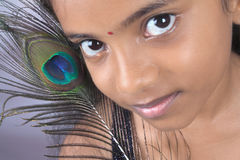 Indian Teenage Girl With Peacock Feather Royalty Free Stock Images