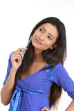 Indian teenage girl with the pen. Teenage girl with her pen in a thinking expression stock photos